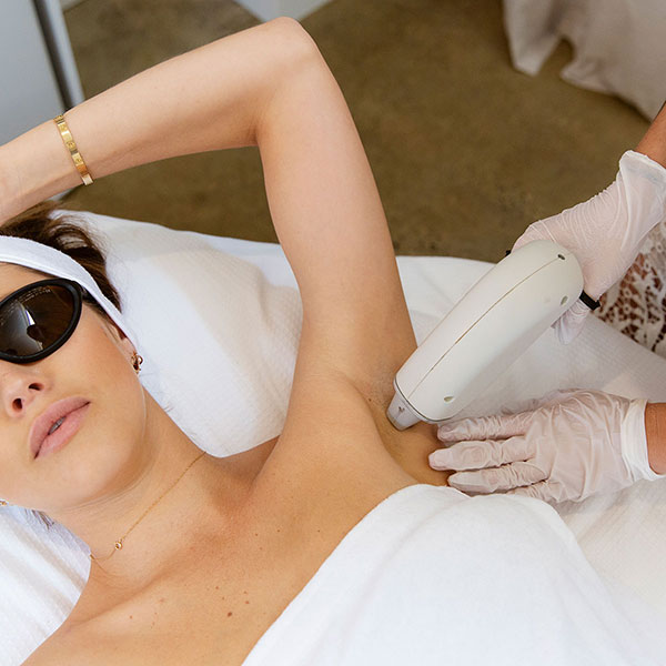 underarms being lasered with hair remover - Laser Hair Removal Byron Bay